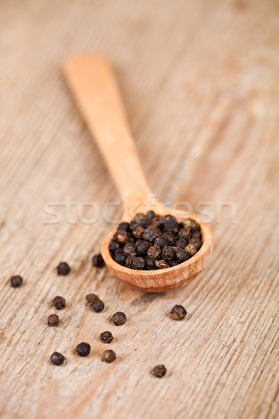 black pepper in wooden spoon Stock photo © marylooo