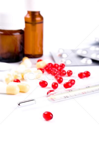thermometer and pills Stock photo © marylooo