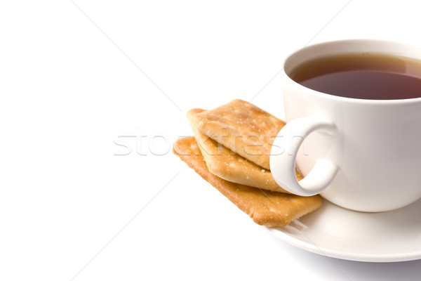 Tasse thé cookies blanche café plaque Photo stock © marylooo