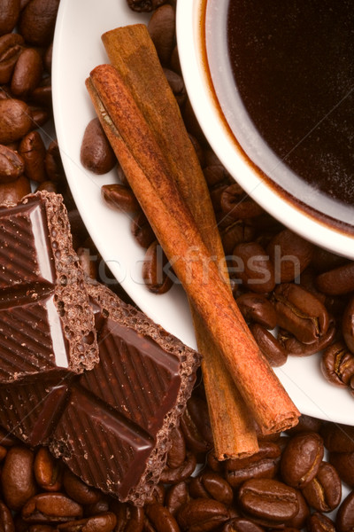 cup of coffee, beans, cinnamon and black chocolate Stock photo © marylooo