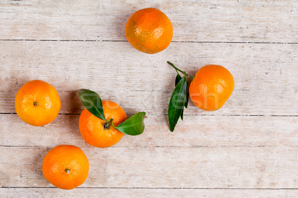 five tangerines with leaves  Stock photo © marylooo