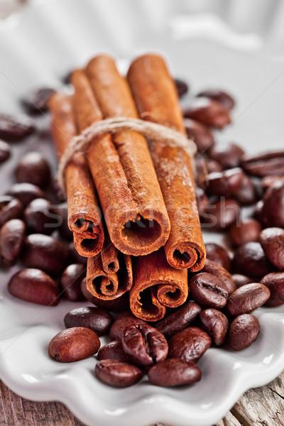 stack of cinnamon sticks and coffee beans Stock photo © marylooo