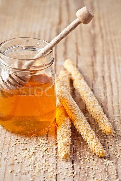 grissini with sesame seeds and honey Stock photo © marylooo