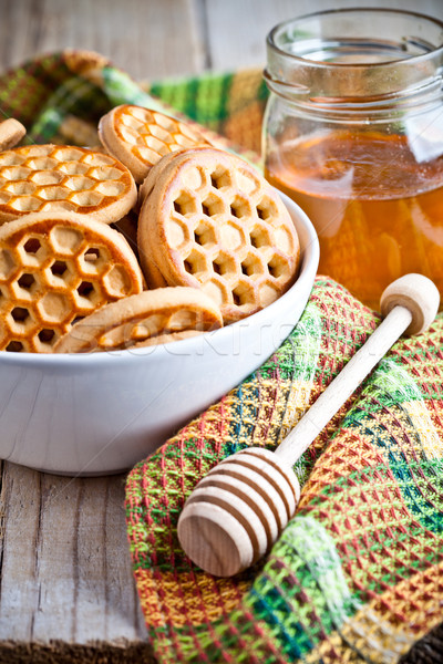 fresh cookies in a bowl, tablecloth and honey Stock photo © marylooo