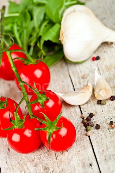fresh tomatoes, rucola, garlic and peppercorns  Stock photo © marylooo