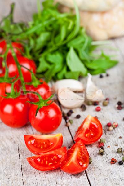 fresh tomatoes, garlic, rucola, peppercorns and buns Stock photo © marylooo