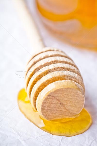 honey on wooden honey dipper  Stock photo © marylooo