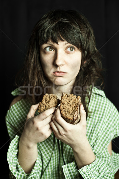 Mendiant femme manger pain portrait pauvres Photo stock © marylooo