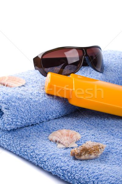 towel, shells, sunglasses and lotion Stock photo © marylooo