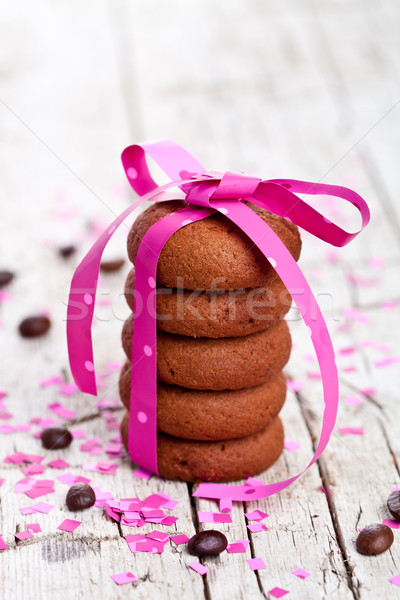 cookies tied with pink ribbon, confetti and coffee beans Stock photo © marylooo