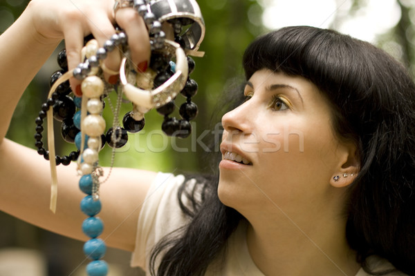 brunette holding a lot of beads Stock photo © marylooo