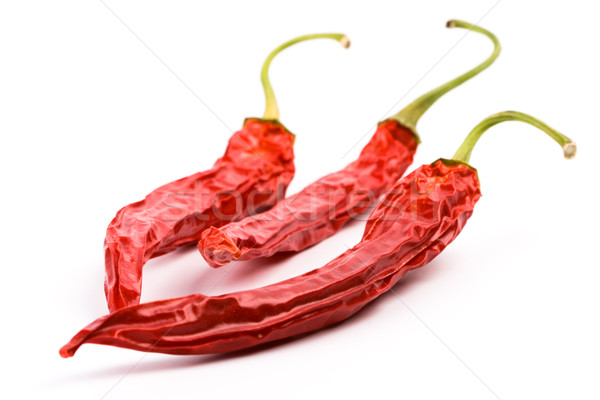 three dry red chilly peppers Stock photo © marylooo