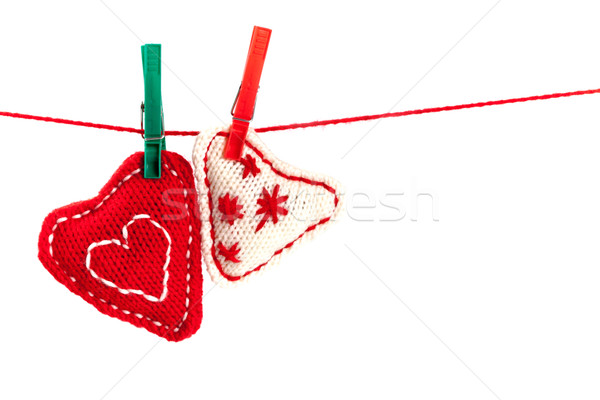 two knitted hearts on a red string Stock photo © marylooo