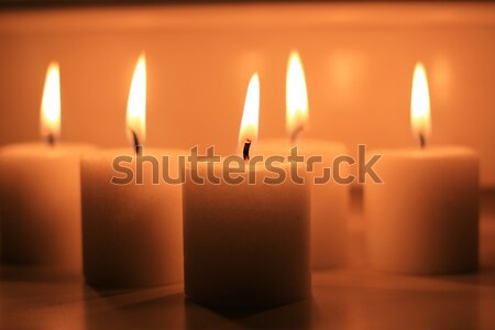 Holiday candles burning on a white background and reflected. Stock photo © MarySan
