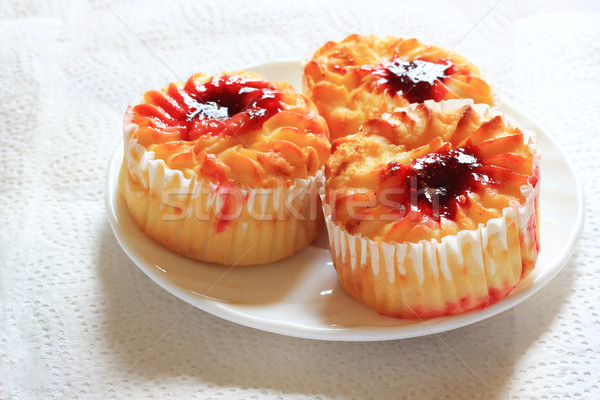 Cheese muffins with cherry jam. A light snack Stock photo © MarySan