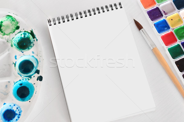 Creative space: an album for watercolors, wood structure, palette, brush Stock photo © MarySan