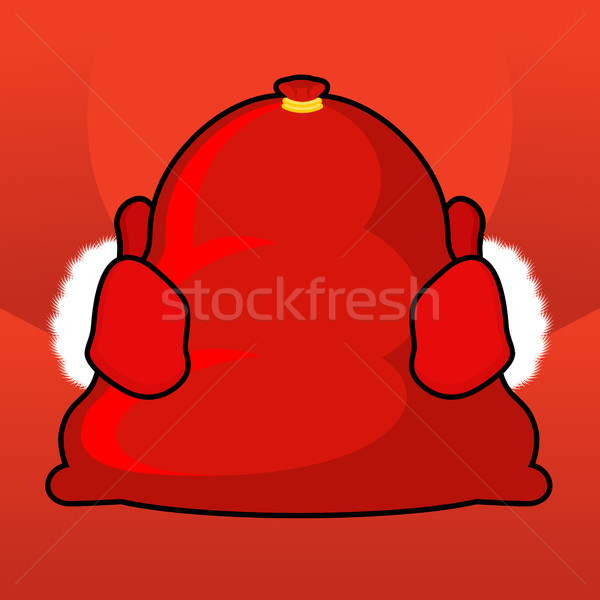 Santa bag and red mittens. Big sack with gifts. Giving gifts at  Stock photo © MaryValery