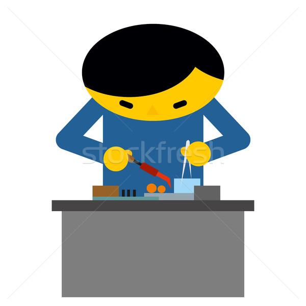 Man behind desk repairs electronic equipment. Engineer in workpl Stock photo © MaryValery