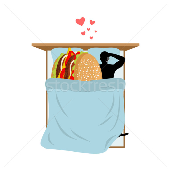 lover fast food. Man and hamburger in bed. Guy and Burger. Lover Stock photo © MaryValery