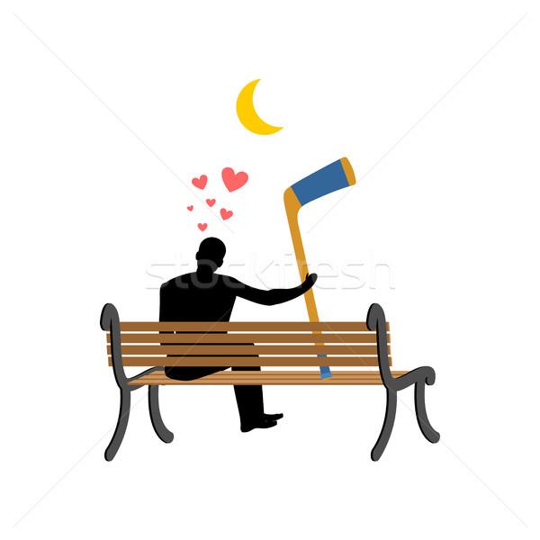 Lover hockey. Man and hockey stick sitting on bench. Romantic da Stock photo © MaryValery