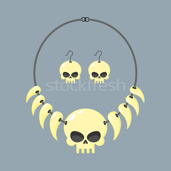 Necklace of skull and tusks. Beads, Aboriginal cannibals and bar Stock photo © MaryValery