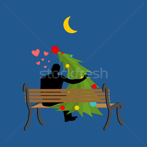 Christmas Lover. Christmas tree and man looking at moon. Date ni Stock photo © MaryValery