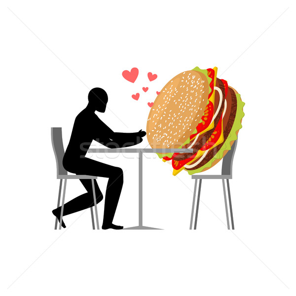 lover fast food. Man and hamburger in cafe. Guy and Burger. Love Stock photo © MaryValery