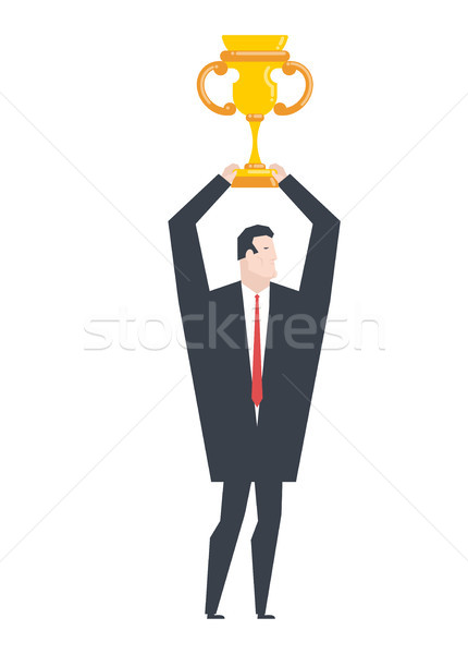 Business winner. businessman holds gold cup in his hands. Award  Stock photo © MaryValery