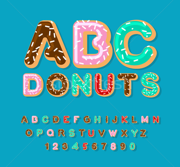 Donuts ABC. pie alphabet. Baked in oil letters. icing and sprink Stock photo © MaryValery