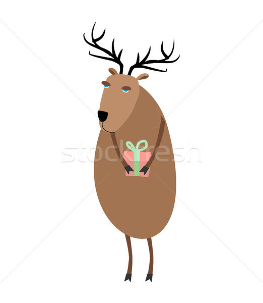 Deer Christmas. Reindeer with gift. Xmas and New Year character Stock photo © MaryValery