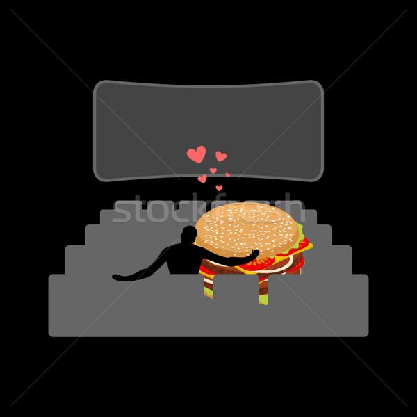 Amoureux restauration rapide homme hamburger film théâtre Photo stock © MaryValery