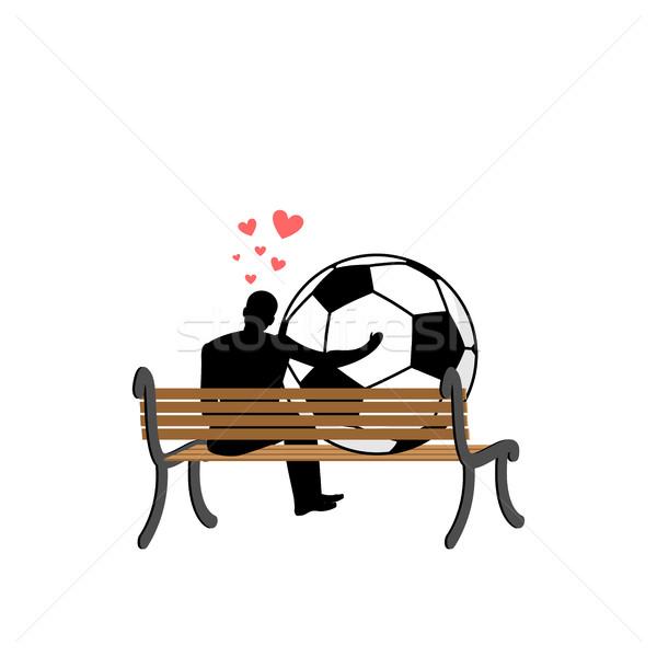 Szerető futball fickó futball labda ül Stock fotó © MaryValery