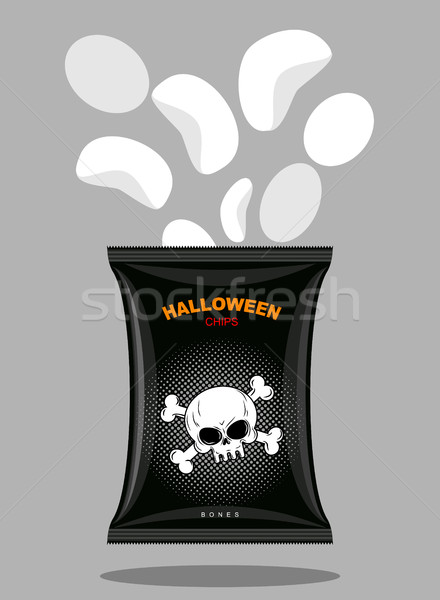 Chips with a taste of bones. Snacks for scary Halloween in black Stock photo © MaryValery
