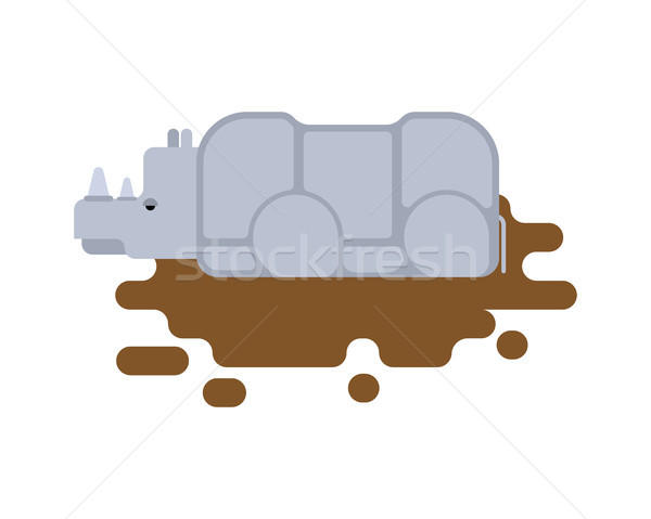 Rhinoceros in puddle. Africa Wild beast. Animal with horn Stock photo © MaryValery