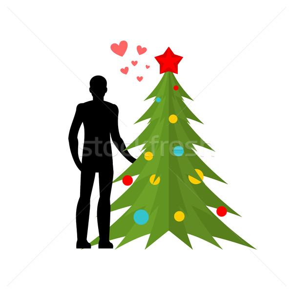 Karácsony szerető szeretet új év férfi karácsonyfa Stock fotó © MaryValery
