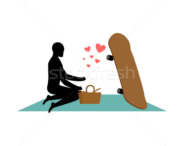 Lover skateboarding. Guy and Skateboard on picnic. Meal in natur Stock photo © MaryValery