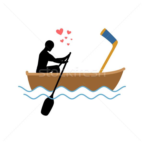 Lover hockey. Guy and hockey stick ride in boat. Lovers of saili Stock photo © MaryValery
