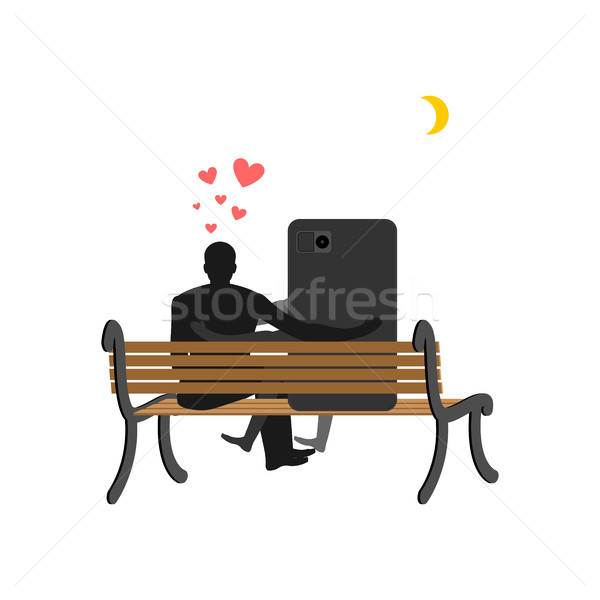 Amoureux homme smartphone séance banc Photo stock © MaryValery