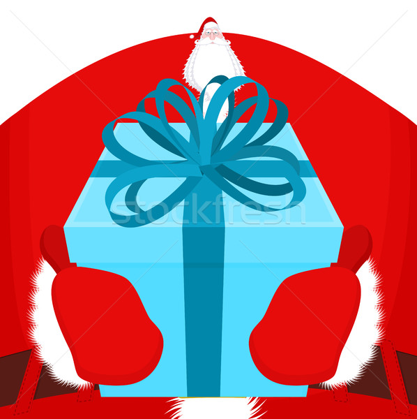 Gift on Christmas. Santa gloves and box with bow. Red tape and y Stock photo © MaryValery