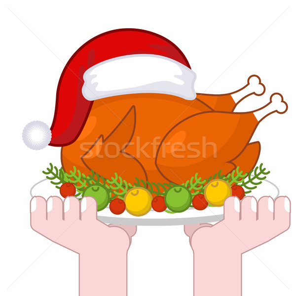 Christmas turkey in Santa Claus cap. Roast fowl on plate with ve Stock photo © MaryValery