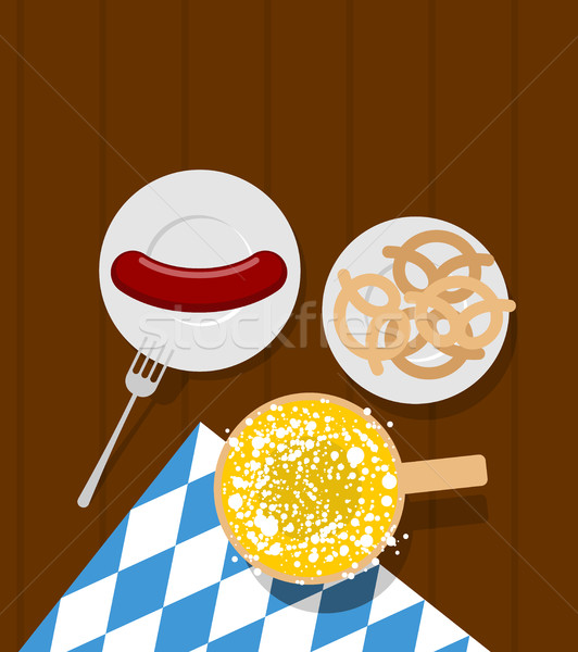Oktoberfest food. Beer and sausages. Pretzels in plate. Meal for Stock photo © MaryValery