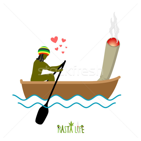 Rasta life. Rastaman and joint or spliff boating. Man and smokin Stock photo © MaryValery