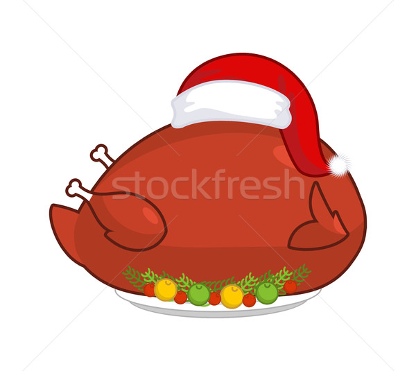 Big Roast turkey in Santa Claus cap. Christmas fowl on plate wit Stock photo © MaryValery