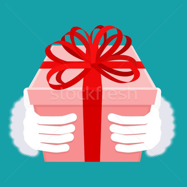 Ajándék karácsony mikulás kéz doboz íj Stock fotó © MaryValery