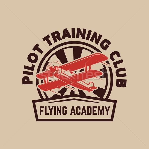 Aviation training center emblem template with retro airplane. Design element for logo, label, emblem Stock photo © masay256