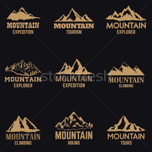 Set of mountain icons in golden style isolated on dark background. Design elements for logo, label,  Stock photo © masay256