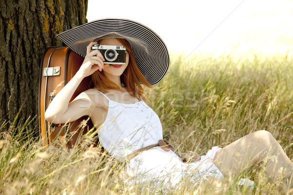 Vörös hajú nő lány ül fa régi fényképezőgép fű Stock fotó © Massonforstock