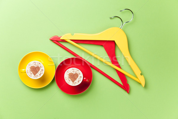 hangers and cup lying on the table Stock photo © Massonforstock