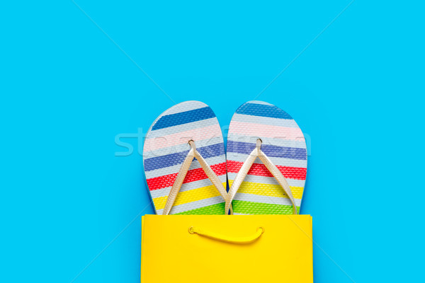 colorful sandals in cool shopping bag on the wonderful blue back Stock photo © Massonforstock