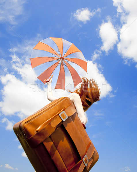 Redhead enchantress with suitcase jump in the sky. Stock photo © Massonforstock